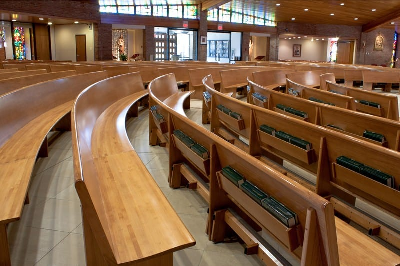 curved pew with bible holder