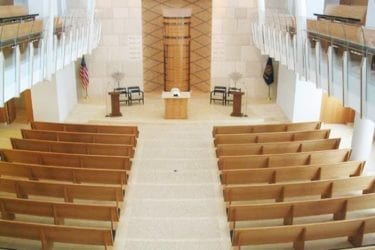 arial view of church with maple curved pews