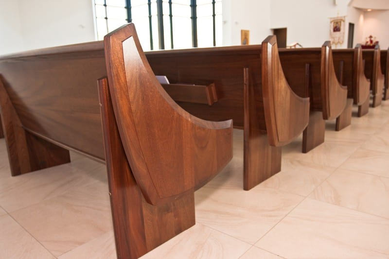 Mahogany wood pew end details