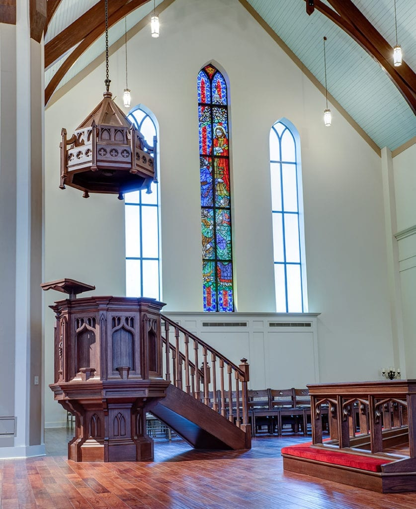 pulpit with stained glass in background