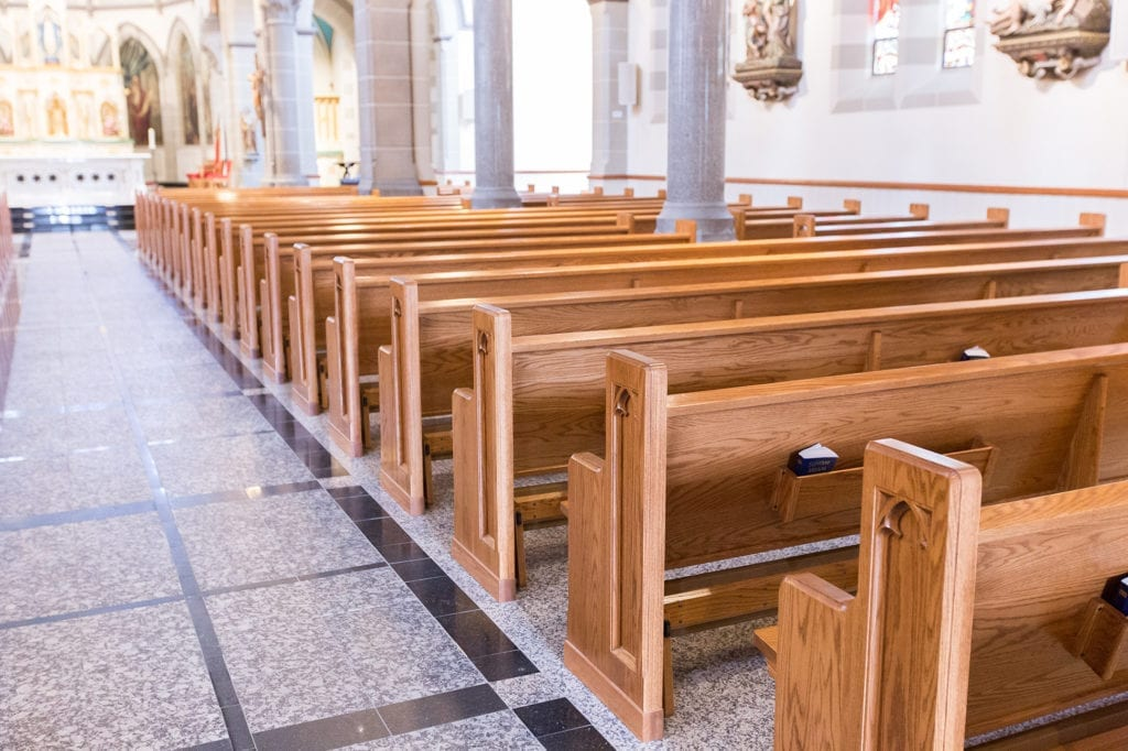 walkway with church pew ends
