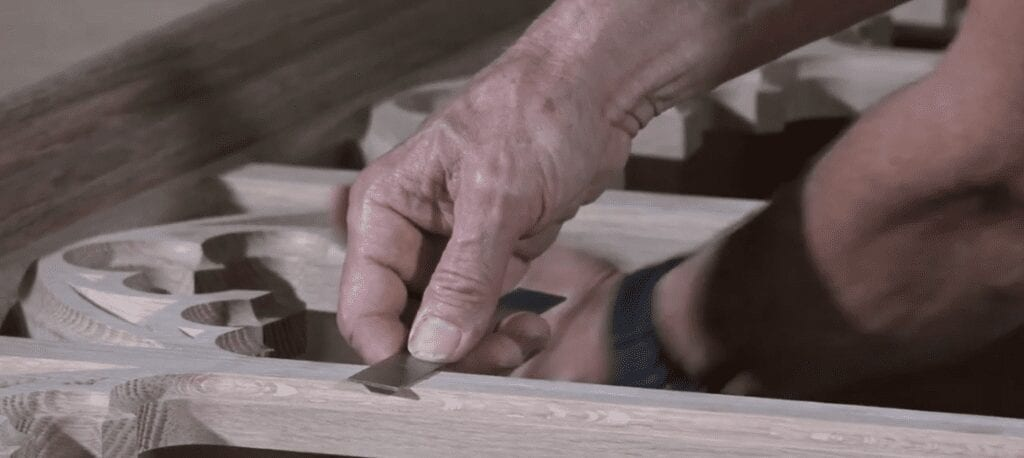 New Holland Church Furniture craftsman shaping new sanctuary furniture piece