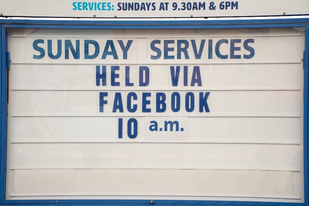 Church sign advertising online Sunday service via Facebook due to COVID-19